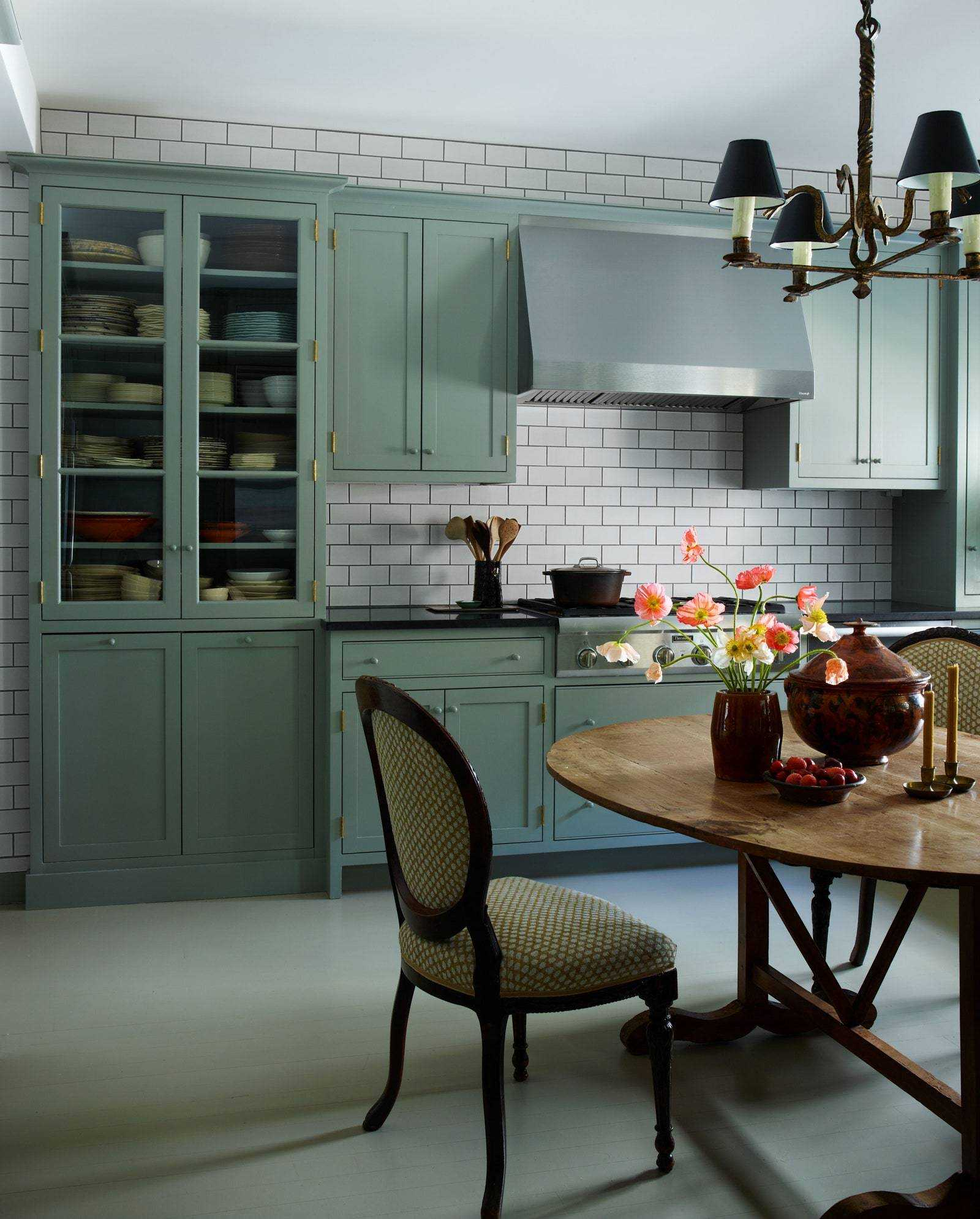 The shaker-inspired kitchen cabinets have knobs that Daniels says disappear so you can read the room what it is ...