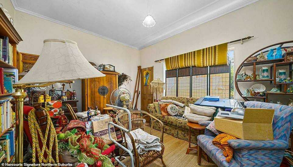 A seven bedroom mansion for sale for $ 585,000 is very crowded.  Exceptionally for a real estate ad, the images show a lot of clutter with a box taking up space on an armchair and junk left everywhere